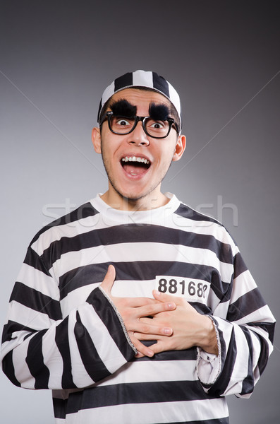 Funny prisoner isolated on gray Stock photo © Elnur