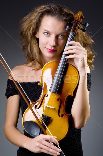 Női musical játékos sötét művészet koncert Stock fotó © Elnur