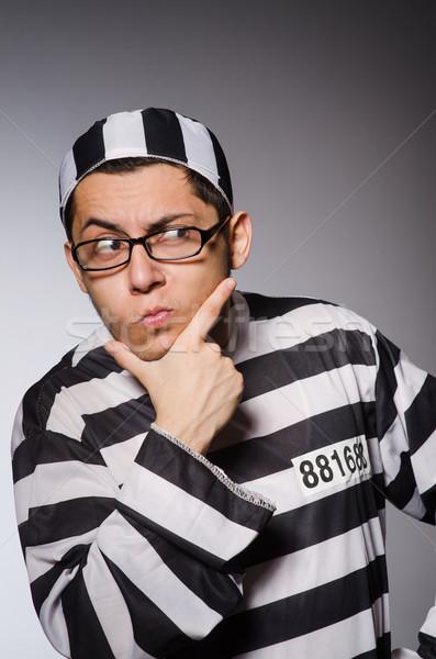 Jovem prisioneiro cinza homem retrato preto Foto stock © Elnur