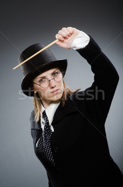 Harry Potter girl with magic stick against gray Stock photo © Elnur