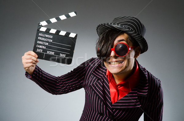 Funny man with movie board Stock photo © Elnur