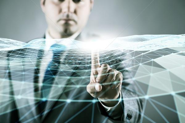 üzletember kisajtolás virtuális gomb futurisztikus számítógép Stock fotó © Elnur
