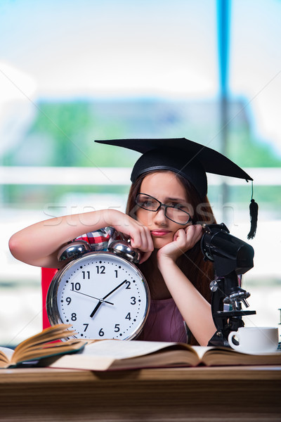 Young girl preparing for exams with large clock Stock photo © Elnur