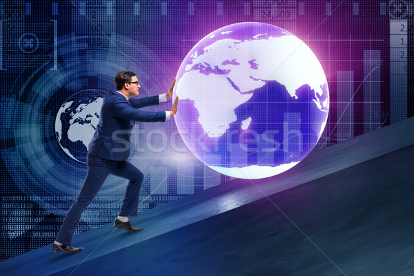 Businessman pushing earth in business concept Stock photo © Elnur