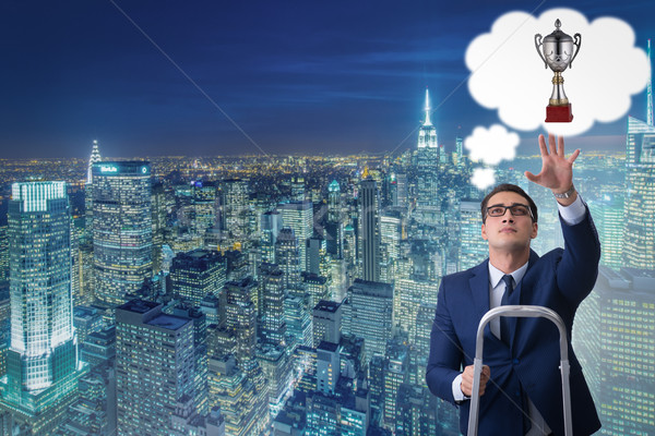 Businessman climbing towards his business goal Stock photo © Elnur