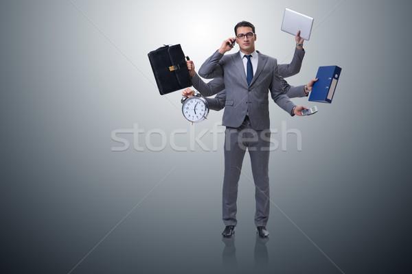 Młodych biznesmen wielozadaniowość działalności komputera człowiek Zdjęcia stock © Elnur