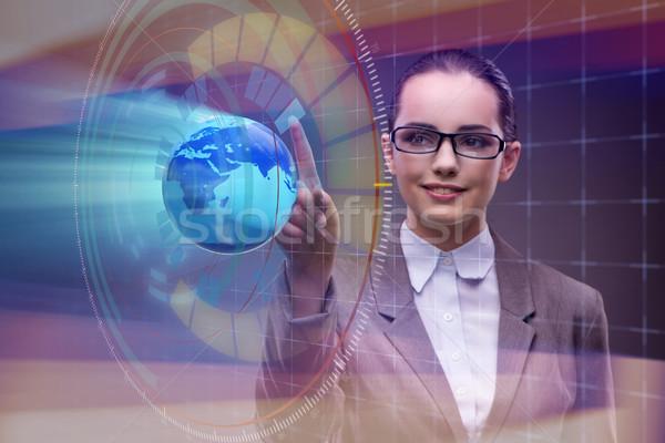 Femme d'affaires commerce mondial affaires bureau main monde Photo stock © Elnur
