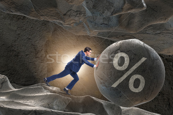 The businessman in high interest debt business concept Stock photo © Elnur
