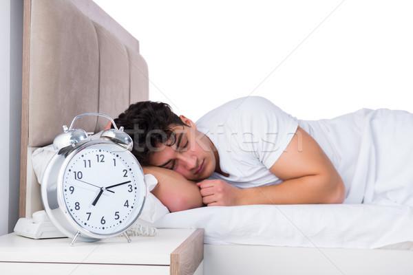 Homem cama sofrimento insônia relógio dormir Foto stock © Elnur