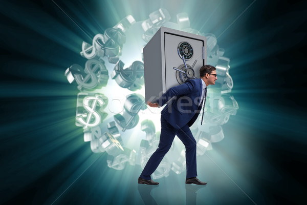 BUsinessman stealing metal safe from bank Stock photo © Elnur