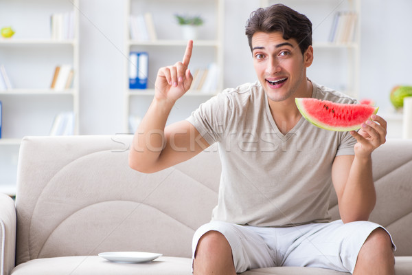 Man eating watermelon at home Stock photo © Elnur