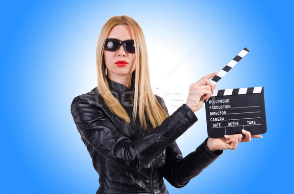 Woman with movie clapper on white Stock photo © Elnur