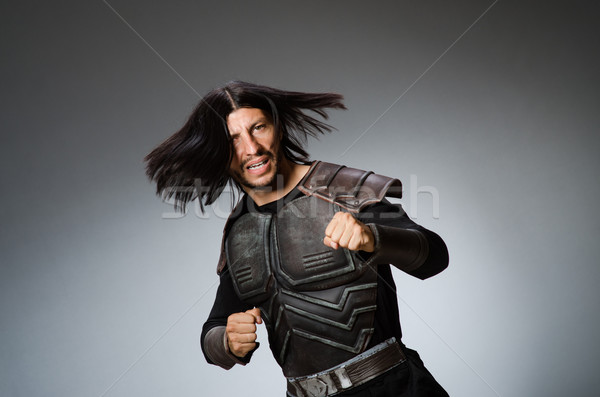 Stock photo: Angry warrior against dark background