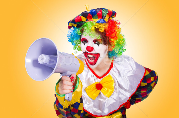 Clown with loudspeaker on white Stock photo © Elnur