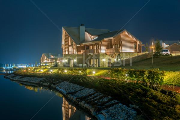 Nice modern house near lake Stock photo © Elnur