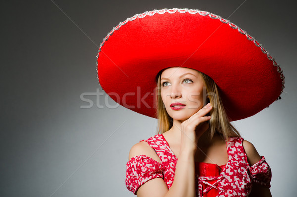 Woman wearing nice red sombrero Stock photo © Elnur