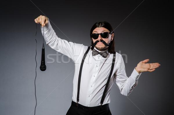 Divertente cantante microfono concerto uomo felice Foto d'archivio © Elnur