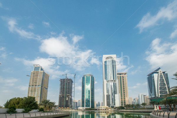 Tall skyscrapers in Dubai near water Stock photo © Elnur
