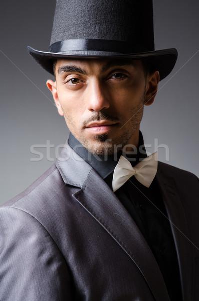 Adam şapka bağbozumu iş ofis gülümseme Stok fotoğraf © Elnur