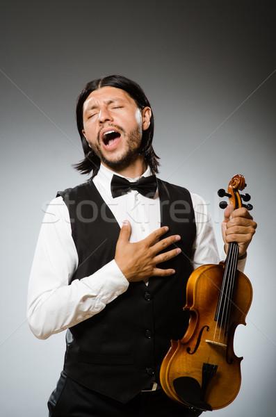 Adam oynama keman müzikal sanat komik Stok fotoğraf © Elnur
