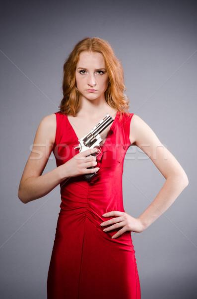 Menina vestido vermelho arma curta cinza mulher fundo Foto stock © Elnur