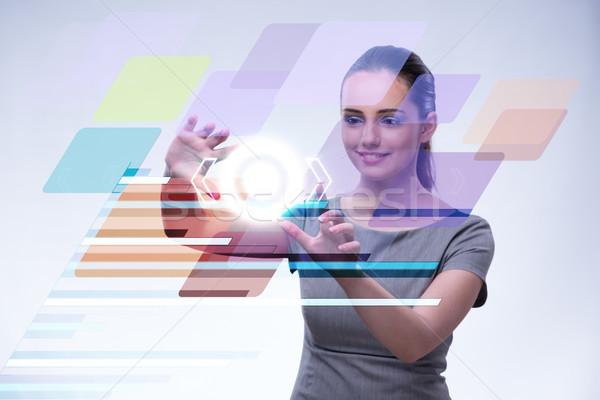 üzletasszony kisajtolás virtuális gombok futurisztikus számítógép Stock fotó © Elnur