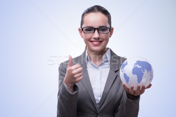 Young bisinesswoman in global business concept Stock photo © Elnur