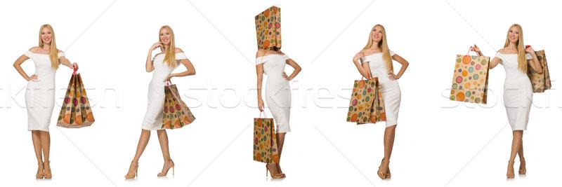 Nő bevásárlótáskák izolált fehér boldog háttér Stock fotó © Elnur