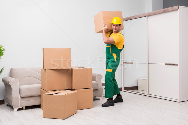 Man delivering boxes during house move Stock photo © Elnur