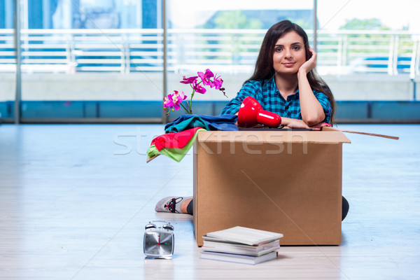 The young woman moving personal belongings Stock photo © Elnur
