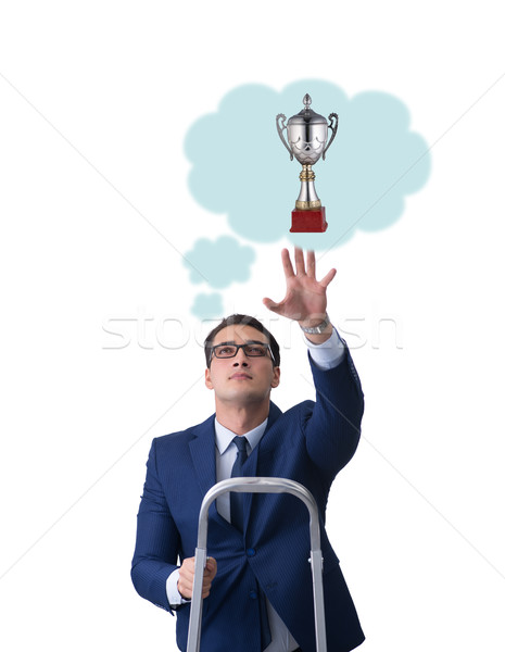 Businessman reaching out for prize cup Stock photo © Elnur