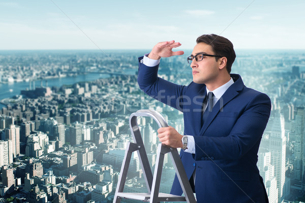 Businessman climbing ladder in business concept Stock photo © Elnur