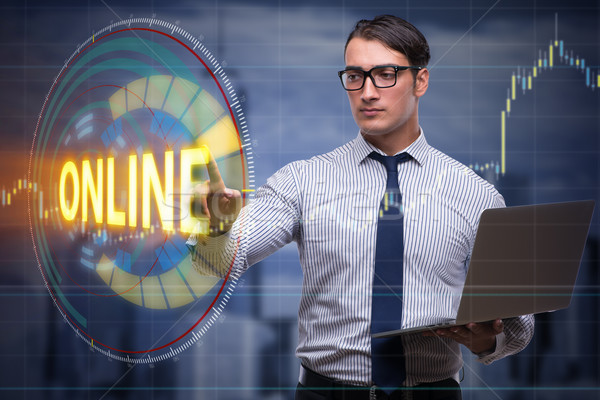Businessman pressing virtual button online Stock photo © Elnur