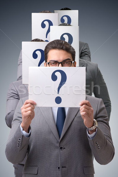 Businessman in uncertainty concept with question marks Stock photo © Elnur