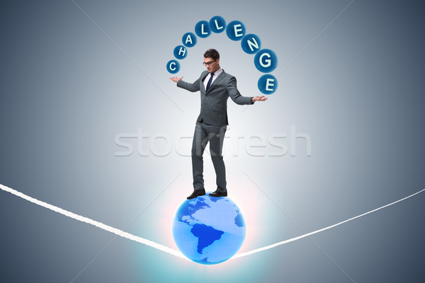Stock photo: Businessman walking tight rop in challenge concept