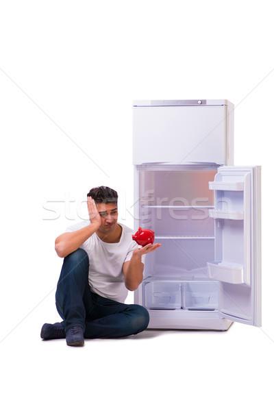 Faminto homem olhando dinheiro geladeira feliz Foto stock © Elnur