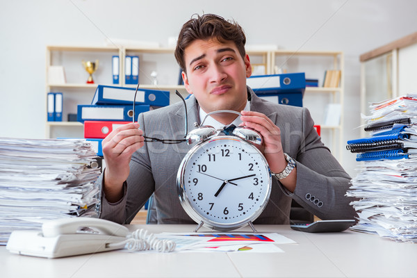 Businessman missing deadlines due to excessive work Stock photo © Elnur