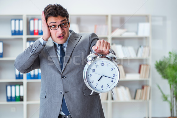 Businessman with alarm clock in the office Stock photo © Elnur