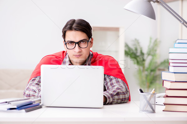 Super hero student with a laptop studying preparing for exams Stock photo © Elnur