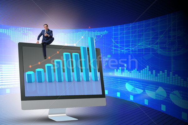 Businessman in economic forecasting concept with charts Stock photo © Elnur