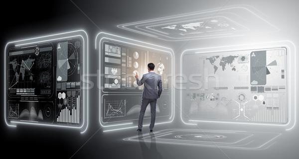 Man pressing virtual button in data mining concept Stock photo © Elnur