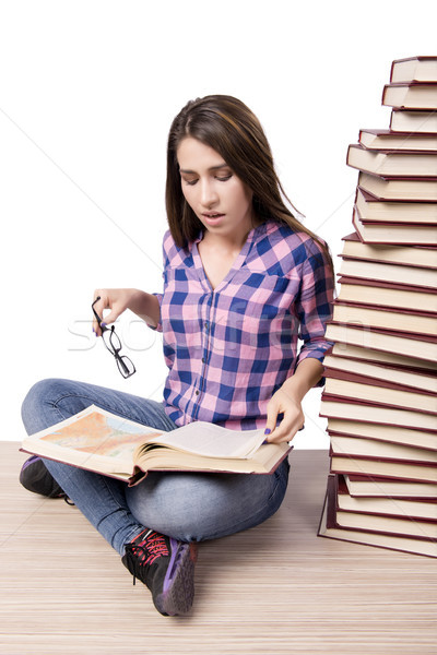 Young student preparing to the college exams isolated on white Stock photo © Elnur