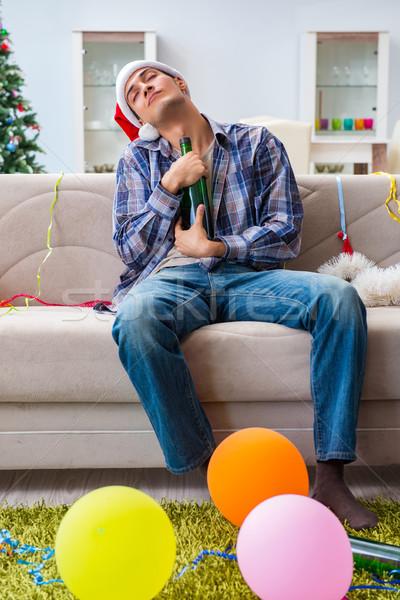 Człowiek kac christmas strony pić zabawy Zdjęcia stock © Elnur