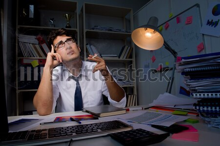 Man businessman working late hours in the office Stock photo © Elnur