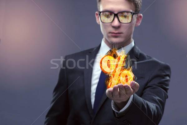 Businessman with percent sign in high interest concept Stock photo © Elnur