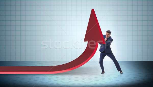 The businessman supporting growtn in economy on chart graph Stock photo © Elnur