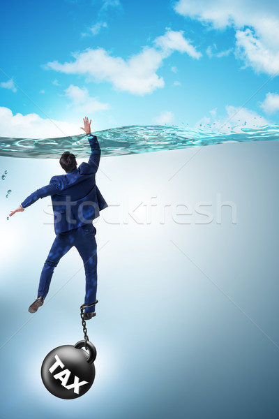 Businessman drowning in concept of high taxes Stock photo © Elnur