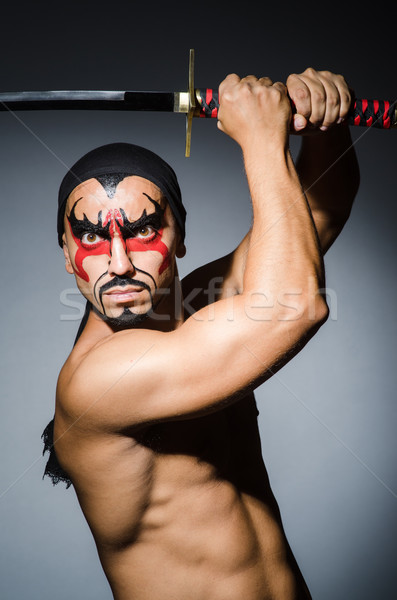 Man with sword and face paint Stock photo © Elnur