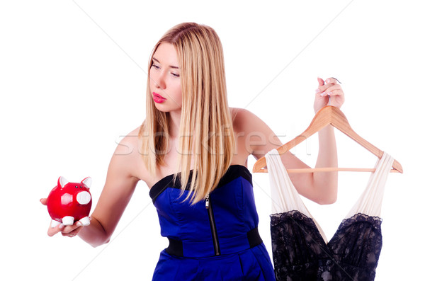 Woman thinking of spending her savings on clothing Stock photo © Elnur