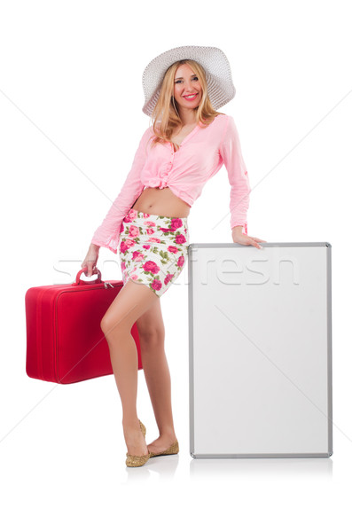 Attractive woman  preparing for vacation with suitcase and blank Stock photo © Elnur